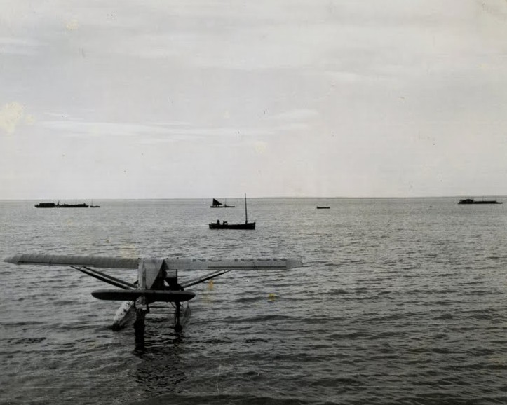 Star Air Service's Pacemaker NC168N in foreground - Alaska fishing boats in background.  Plane was wrecked in 1946 and recoved and is on display at the Alaska aviation Heritage Museum. - 965